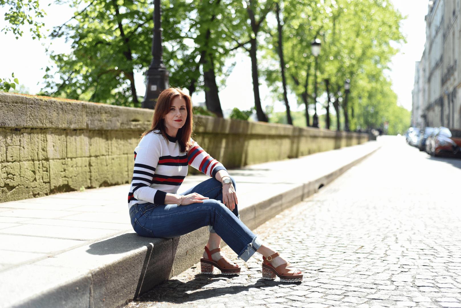 Leah sitting on street on Ile Saint-Louis